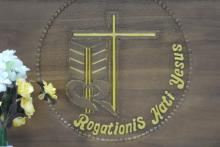 The Rogationist emblem in the local language; engraved on the altar of the seminary chapel.